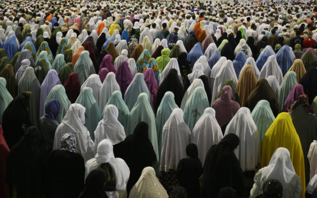 Muslim women pray outside Mecca's Grand Mosque on November 15, 2009. Some 2.5 million Muslims from more than 160 countries converge annually on the Islamic holy cities of Mecca and Medina in western Saudi Arabia. The hajj pilgrimage -- to be completed at least once in a Muslim's lifetime, under the tenets of Islam -- can be undertaken at any time, but peaks this year from November 25 to 29, at the height of the alert over swine flu.  AFP PHOTO/MAHMUD HAMS (Photo credit should read MAHMUD HAMS/AFP/Getty Images)