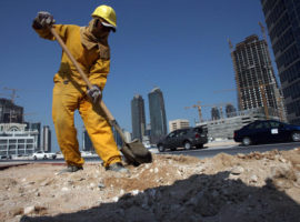 TO GO WITH AFP STORY BY FAISAL BAATOUT: A construction worker digs at a building site while in the background numerous cranes are positioned around high-rise ?apartment buildings under development in the Qatari capital Doha, 01 October 2007. Qatar ?is enjoying dramatic economic growth on the back of surging gas revenues, but the Gulf ?state is battling an increasingly high rate of inflation led by high housing costs, officials ?and analysts say. Around 2,000 housing units were under construction in 2007 and ?another 6,000 should be ready by 2009. AFP PHOTO/KARIM JAAFAR (Photo credit should read KARIM JAAFAR/AFP/Getty Images)