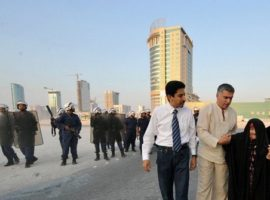 Abdulhadi al-Khawaja and Nabeel Rajab helping an old woman after police attacked a peaceful protest, Bahrain, August 2010