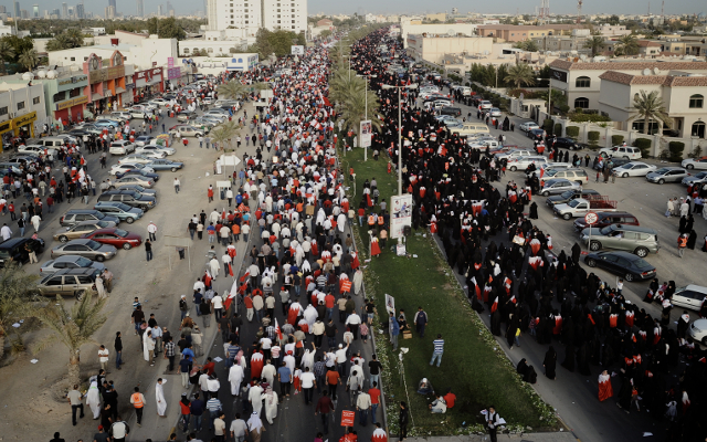 BAHRAIN, Budayia City: Bahraini Shia Muslem attending anti-government rally in a  Budayia City, West Manama Capital Manama, on March 09, 2012